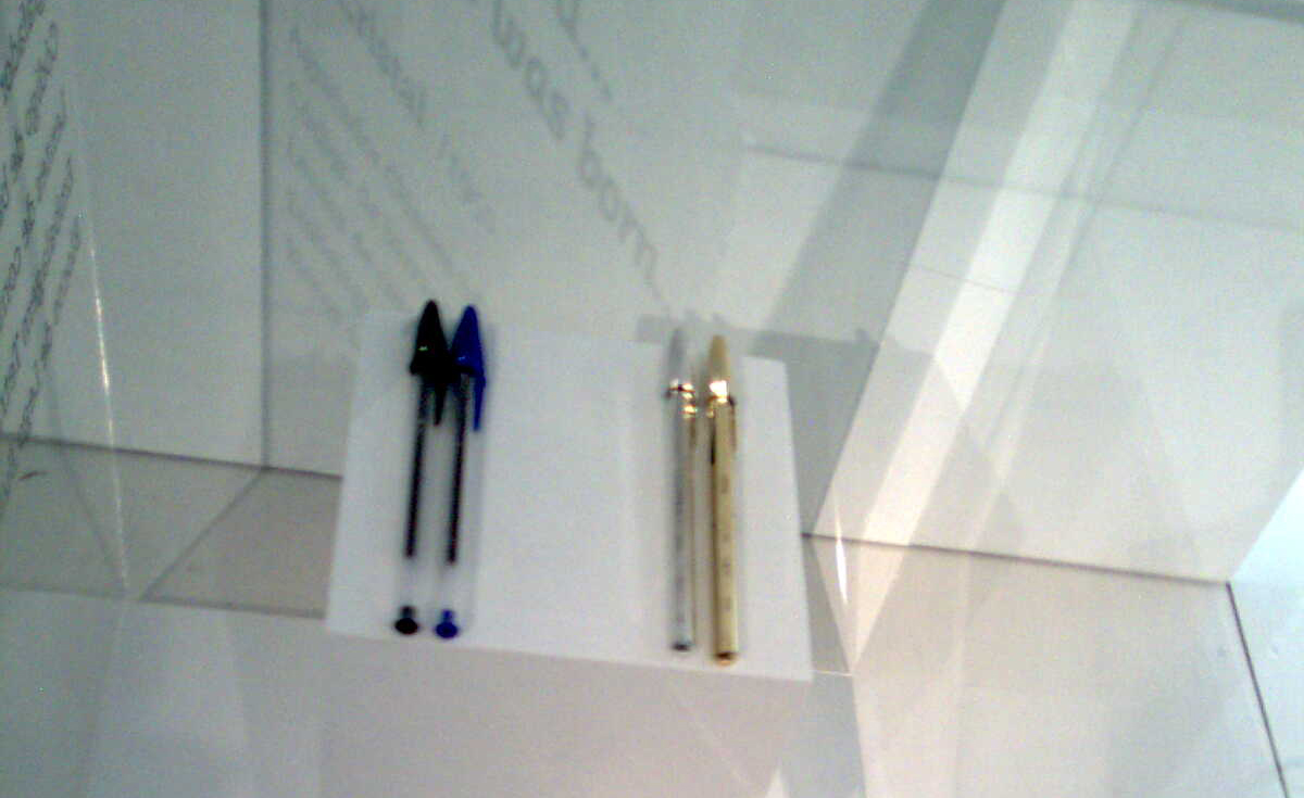 4 pens in a exhibition